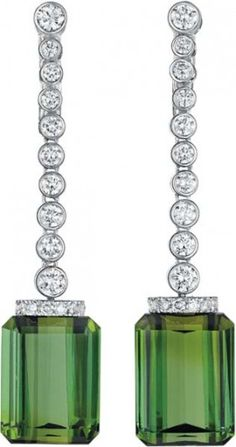 """A Pair of Tourmaline and Diamond, signed Aletto Brothers. Pave' set diamonds in platinum and 18k white gold and the two tourmalines each 2""""in length and roughly 2ocarats in total. Pitter patter goes the heart."""