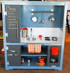 An old entertainment unit turned into a play kitchen. Awesome idea