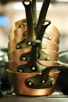 Copper pots are awesome to cook with and look really cool, too. Mix in some cast…