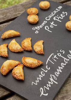 Passed hors d'oeuvres were handwritten on a slate tile for easy ID.  Mini empanadas and pot pies, Creative Edge Parties; slate tray,