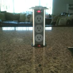 Telescoping power outlet for large granite island in kichen