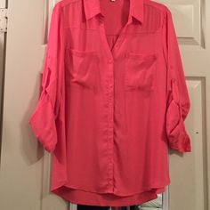 Express Portofino Shirt Salmon colored portofino shirt. Only used it a few times for work. Size L, 100% polyester Express Tops Button Down Shirts