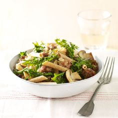 Lightening up this hearty pasta dish is easy with a simple switch to multi-grain penne and generous helpings of mushrooms and kale. Switch out the kale for arugula to add a subtle, peppery element.