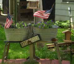 find an old wash stand and washtubs and you have a unique planter...I have both of these in the store right now!