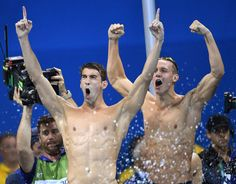 Michael Phelps (L) and Caeleb Dressel of USA celebrate their team's victory in the men's 4x100m Freestyle relay final race of the Rio 2016 Olympic Games Swimming events at Olympic Aquatics Stadium at the Olympic Park in Rio de Janeiro, Brazil, 07 August