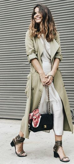 Oversized trench coats are a must this Fall. Via Sara Escudero.  Trench: Zara, Dress: Rebecca Minkoff.
