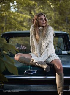 Bridget Malcolm poses on the back of a pickup truck in Purl Harbour sweater and Hermes boots