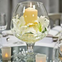 Centerpieces can be as easy as a wine glass with a candle! What do you think?