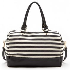 Black & whtie striped weekender bag crafted from soft canvas fabric with a removable long strap and top shoulder handles