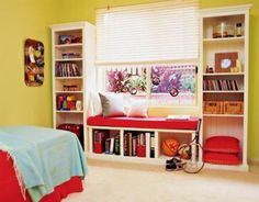 Two bookcases alongside a window with a bench between makes an easy and cosy DIY reading nook.