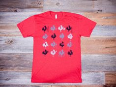 Made in USA by American Apparel. Men's t-shirt with Big Rock rooster emblem. Comes in red, black, white, blue.