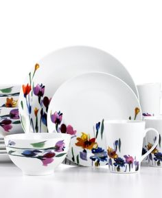 This is a porcelain entertaining service garden dining home set dinnerware from Mikasa, the tableware (plates and platters and serving bowls etc.) used in serving a meal.