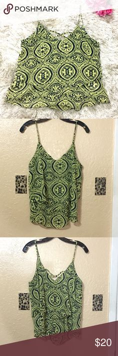 Francesca's Flowy Tank Blue and green printed tank. Flowy fit. Size medium. Small criss cross detail in back. Originally purchased from Francesca's. Feel free to ask questions!  Francesca's Collections Tops Tank Tops