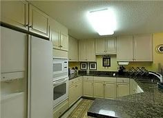 Floor Plan & Sq: Footage:- (C) - 1144nsf. Flooring: Travertine tile w/ carpet-brightly painted & granite in kitchen TV (4), DVD (3), VCR (1), stereo L/R: Tan SS w/ chaise 2 rust swivel chairs, green o...