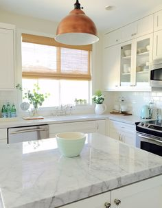 Love this white farmhouse kitchen and that brass light eclecticallyvintage.com