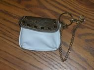 Price $9.97 . Snap front closure for the change purse Slip pocket in back. Studs on front of change purse some show some wear of the color. Cute for w...