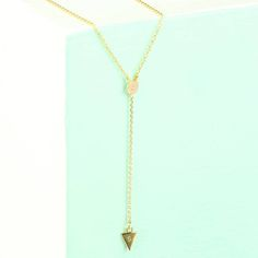 A beautiful Y drop necklace, personalised with an initial stamped onto the triangle pendant.<em>Personalisation: get your initial of choice hand-stamped onto the small triangle pendant hanging from the drop chain.</em>This necklace from Orelia will make the perfect addition to an outfit fit for a fancy dinner or night on the town. With its slender and delicate trace chain and tiny pendants, this necklace is sublte and stylish. The triangle pendant at the bottom of the drop chain will be…
