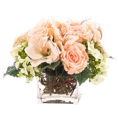 Bring organic elegance to your decor with this lovely faux amaryllis and rose arrangement from Natural Decorations, Inc., nestled in a glass vase. Made in th...