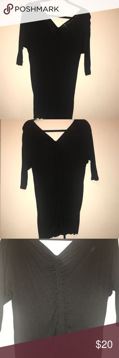 GAP Black Cotton Long-Sleeve V-Neck Ruched T-Shirt GAP Black Cotton Long-Sleeve V-Neck Ruched T-Shirt. V Neck on back and front. Ruching on back with ties that have gold beads. Ruching can be increased/decreased by pulling like a drawstring. GAP Tops Tees - Long Sleeve