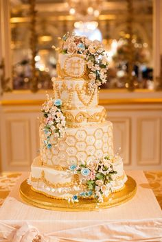 Gilded Five Tier Wedding Cake with Fondant Flowers | Amaryllis Floral & Event Design | Luminosity Photography & Design https://www.theknot.com/marketplace/luminosity-photography-and-design-townsend-de-660438