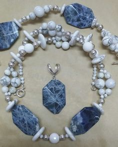 Necklace of Sodalite, Howlite, silver & agates with a clip on enhancer.