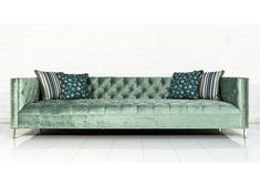 """Upholstered in Brussels Aqua Velvet Fabric, hand tufted and finished with polished brass nail heads and 4"""" brass legs. Combining clean lines and a thin frame with the classic tufting, it's a beauty fo"""