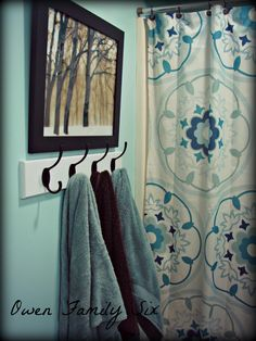 Bathroom Towel Hooks – guest bath instead of towel bars. Allows multiple towels to be hung without taking up wall space for multiple towel bars