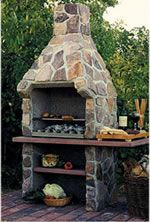 """Is Nexo a fireplace or a BBQ grill? Why, both of course! This awesome outdoor fireplace is designed and built on the Danish Island of Mors by master craftsmen from """"steel-reinforced, pumic-stone refractory core covered with beautifully colored sandstone rock or with stucco."""