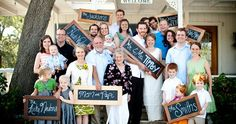 Family Photo - picture with chalk board signs to identify each family.