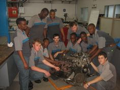 Apprentices at the BMW academy stripping down engine for rebuild