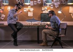 Young adult Caucasian colleagues using holographic augmented reality glasses together, discussing shark model hologram. Game development