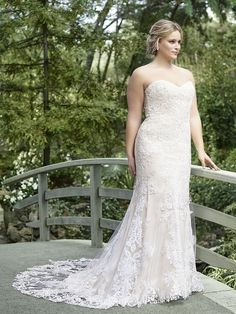 7d4364bb008 Shop the Casablanca Bridal Laurel wedding dress! This fit-and-flare gown  features lace on net fabric