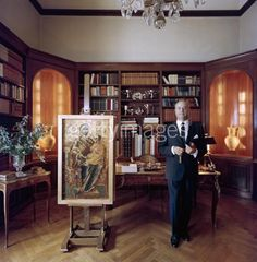 Professor Stratis G Andreadis, President and Chairman of the Board of the Commercial Bank of Greece, in his study in Athens, 1961. He is also a shipowner, former statesman and art collector, and this Byzantine icon is one of his most prized possessions. Photo by Slim Aarons, 1961.