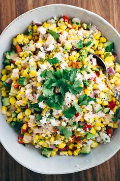 Mexican Street Corn Salad with Chipotle Dressing - This recipe is a fiesta in a bowl! A healthy salad packed with fresh vegetables and creamy chipotle yogurt dressing. | jessicagavin.com