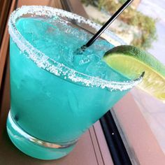 Electric Margarita    Ingredients:  • 1½ oz. tequila  • 1½ oz. fresh lime juice  • ½ oz. Blue Curacao  • ¾ oz. agave nectar