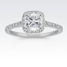 This stunning halo engagement ring would look brilliant with your chosen cushion, asscher, round or princess cut diamond.