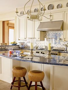 Light blue toile ceramic tiles above the stove top gives this Florida ...