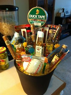 The man bouquet!!! SAVING THIS FOR VALENTINES :) It includes various bottles of alcohol, cigars, jerky, duck tape, scratch-offs ect