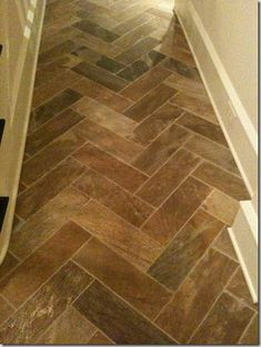 stone tile in a herringbone pattern...this would gorgeously blend with a reclaimed wood floor (mudroom to livingspace transition)