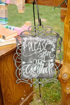 Cute chalkboard sign for guestbook. Photo by The Tarnos. #chalkboard #guestbook #calligraphy