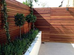 Small garden design London Clapham Balham ideas low maintenance grey tiles Contact anewgarden for more information Small Garden Design Ideas Low Maintenance, Low Maintenance Landscaping, Low Maintenance Garden, Garden Design London, London Garden, Modern Garden Design, Modern Design, Amazing Gardens, Beautiful Gardens