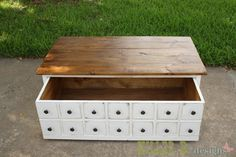 Apothecary Coffee Table with Toybox Trundle - Or a nice place to put extra blankets or craft supplies if you don't have kids... or dog toys if you have the four legged kind! This is genius!!!