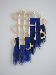 Hand formed ceramic piece in contrasting finishes: unglazed beige stoneware and unglazed white stoneware with applied gold foil detailing. Cobalt and deep navy cotton fringe. Saw tooth hardware adhered to back for hanging. Textile Fiber Art, Textile Artists, Ceramic Pottery, Ceramic Art, Sculpture Art, Sculptures, Abstract Sculpture, Dream Catcher Decor, Handmade Wall Hanging
