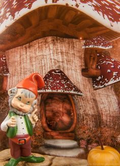 Mini silly gnome in the fall enchanted fairy garden.
