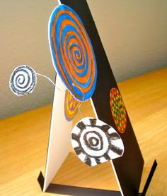 Fine Lines: Calder Meets Hundertwasser: Kinetic sculpture:wire, mat board, paper, color theory