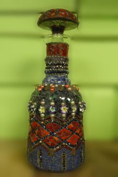 genie in a bottle baby  2014  Carol Sabo  spontaneous mosaic  sculpture  on crystal decanter      im a genie in a bottle baby... I started