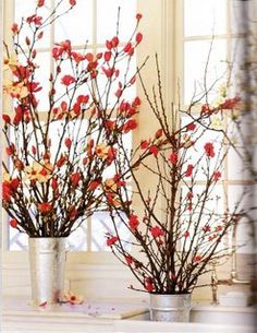 Branches with apple colored flowers/berries in a silver container (something a little more polished than these buckets though).