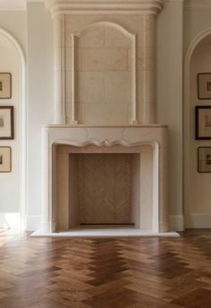 Limestone Fireplace | Hardwood Floor in a Herringbone Pattern