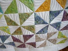 I like the quilting on this - it adds more movement to the pinwheels.