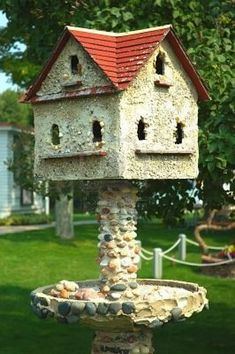 Stone Bird House - reminds me of the birdbath that Doug's grandfather made. I think it needs to go to the garden this year.
